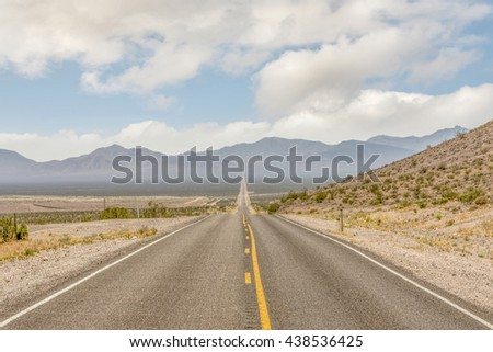 Road American road trip in desert and mountain road with open blue sky, long road with nobody on road. Yellow line on road.  road road road road road road road road road road road road road road road
