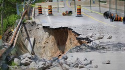 road and bridge erosion due to too much  springtime rainfall