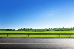 road and field of spring grass