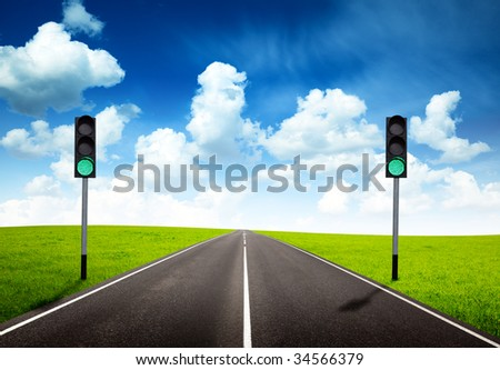 road and green traffic light - stock photo