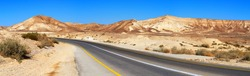Road and landscape of the Negev desert near the city of Arad.