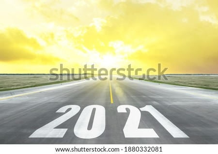 Road and sky in trend colors vibrant Illuminating yellow and ultimate gray with inscription numbers 2021 year, stripes direction to the horizon