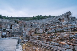 road and stone walls going to historical Theatre in Ephesus ruins, historical ancient Roman archaeological sites in eastern Mediterranean Ionia region