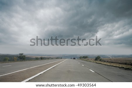 road and storm clouds