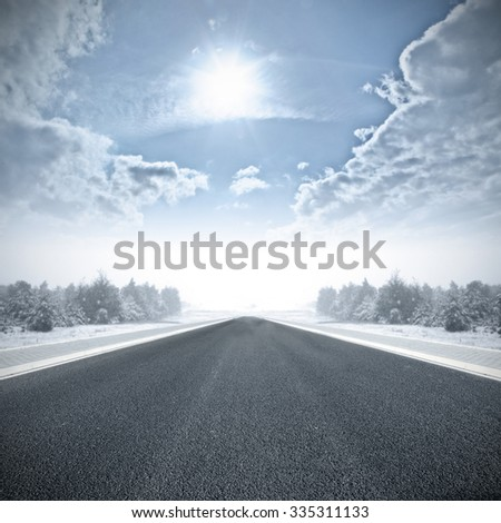 road and sun on blue sky
