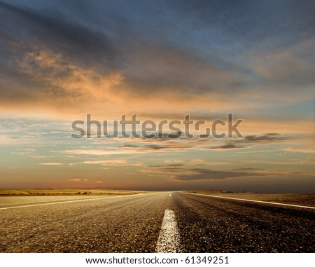 Stock Photo Road and the sunset sky