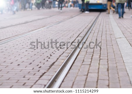 Road and Tram way in Amsterdam, capital city of the Netherlands with people walking on path. #1115214299
