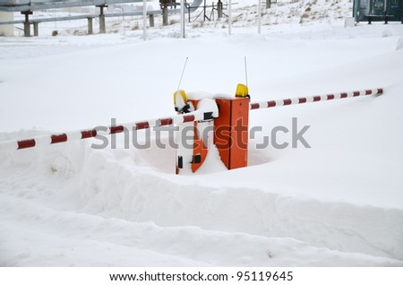 Road barrier covered by snow