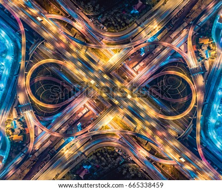 Road beautiful Aerial View of Busy Intersection , top view , Thailand at night