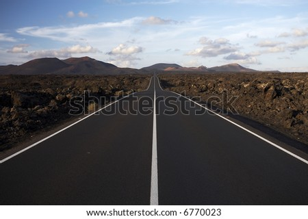 Road between rocks - stock photo
