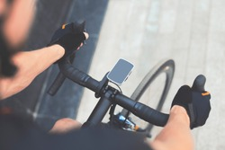 Road Bike With GPS Navigator With Smart Watches on Cycle Handle Bar. Blank Screen With Copy Space. Eco Friendly