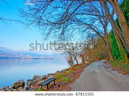 Road by the beautiful lake Orestiada of Kastoria city in north-west Greece