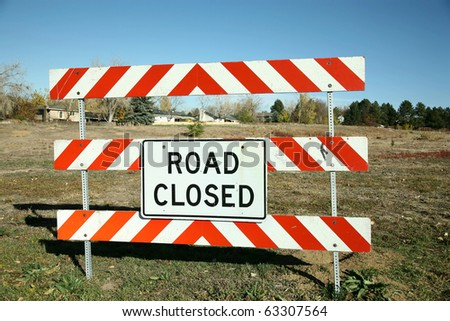 Road Closed Sign - at the entrance to a field.