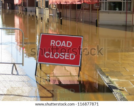 Road closed sign in flooded street. York, North Yorkshire, UK. - stock photo