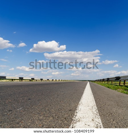 road closeup under blue sky
