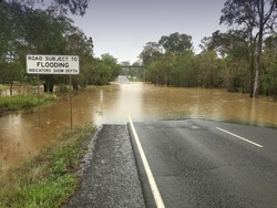 Road closure and flooding Australia. Location: Gympie, Sunshine Coast on on Can Bay Road
