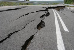 Road collapses with huge cracks. Earthquake. International road collapsed down after bad construction. Damaged Highway Road. Asphalt road collapsed and fallen.