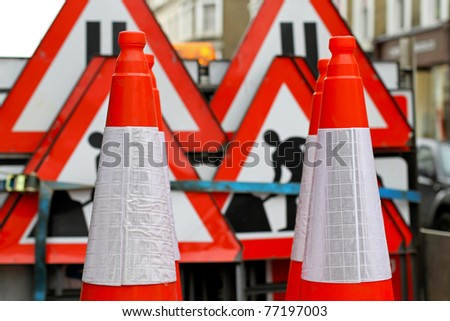 Road cones and traffic signs for construction safety