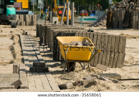 Road construction barrow with blurred background