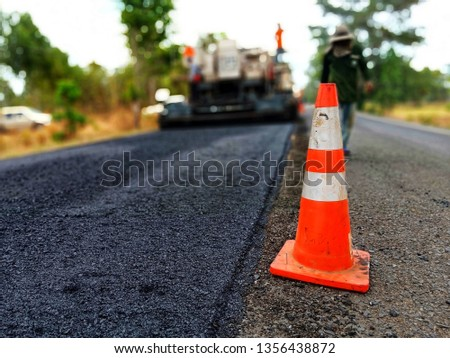 Road construction by burning asphalt road Then paved with new asphaltic concrete materials, blurred images #1356438872