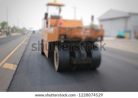 Road construction in Thailand, picture blurred #1228074529