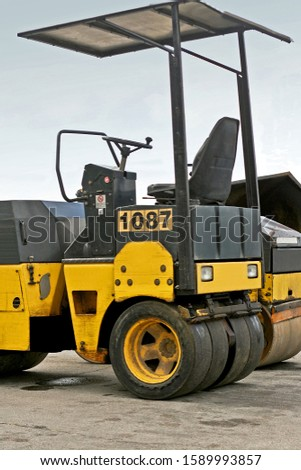 Road construction roller heavy equipment machinery yellow