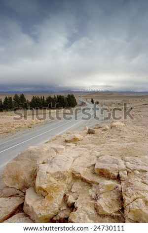 Road converging to infinity in the middle of the desert, Morocco - stock photo