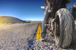 Road crossing the Death Valley, motorbike ready to ride