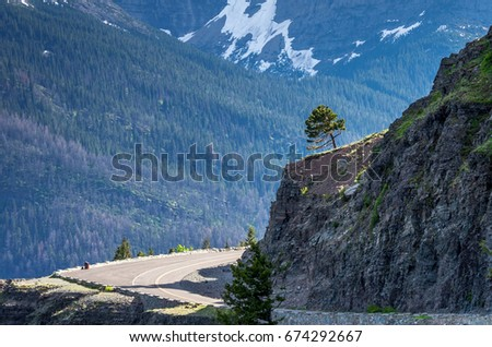 Road Curving Around Mountain  #674292667