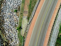 Road cut off the sea and mountains. The blue sea along the way. Photos from the top to the bottom.High angle view