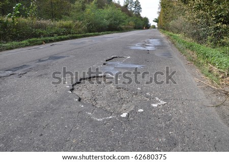 Road damaged after winter. A hole in the road.