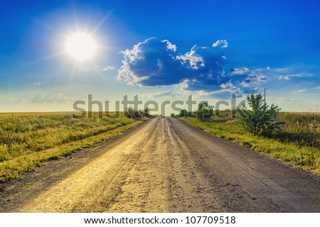Road,  evening sky and sun. Sunset.