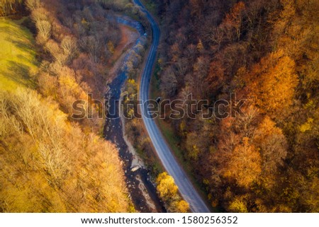 Road from above in scenic autumn valley. Mountain landscape with highway.