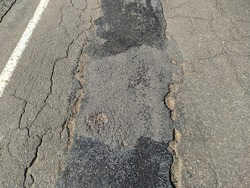 road from broken and destroyed asphalt unsuitable for driving
