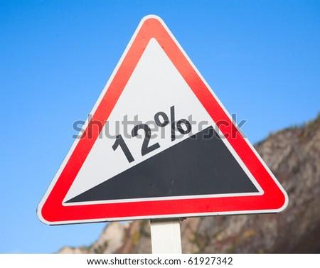 Road grade 12 per cent, road sign