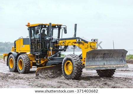 Road grader - heavy earth moving on dirty ground