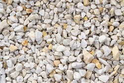 Road gravel, crushed stone. Gravel texture. Crack stones at a construction site. Seamless texture of white stones or gravel