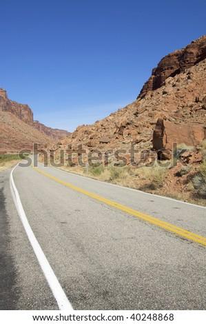 road in a arid landscape near Moab, Utah, Usa