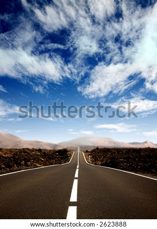 road in a rural area with a nice sky