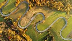 Road in autumn scenery - aerial shot