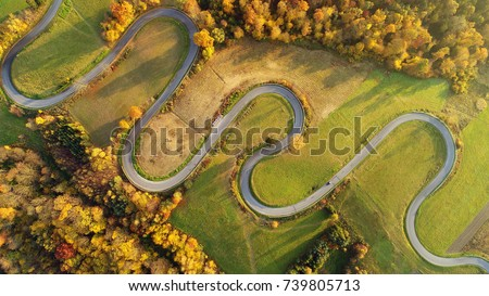 Road in autumn scenery - aerial shot