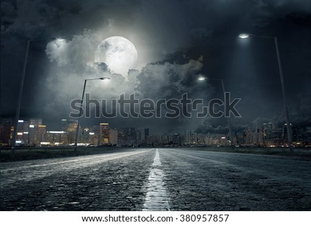 road in city at night