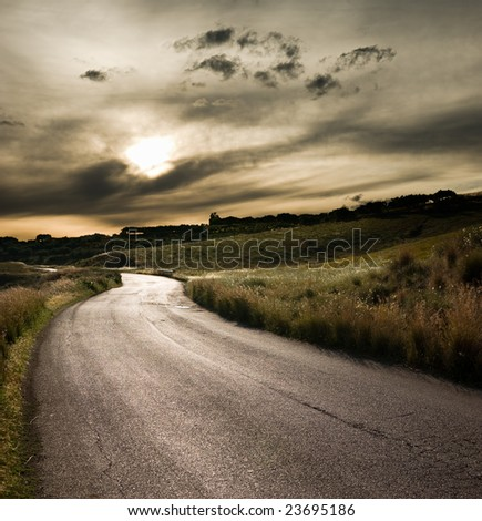 road in middle of rural area to evening