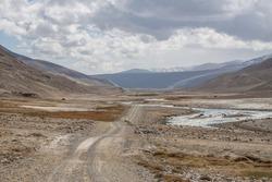 Road in Pamir River valley on the Afghan and Tajik borderline