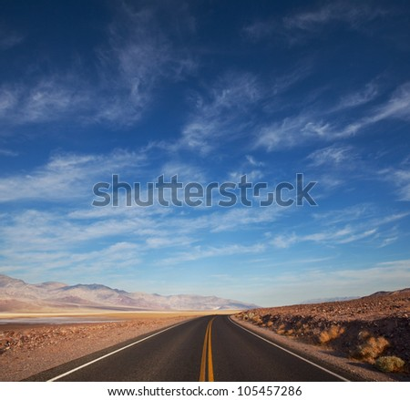 road in prairie - stock photo