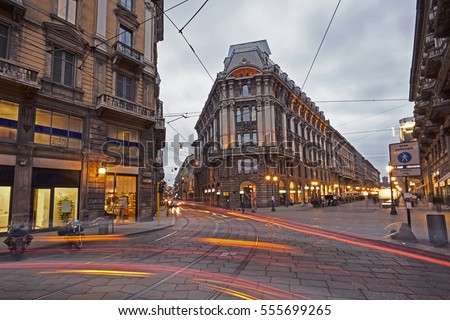 Road in the centre of Milan with long exposure illuminated at sunset #555699265
