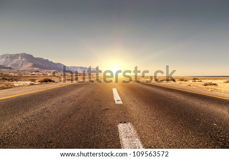 Road in the desert and sunset