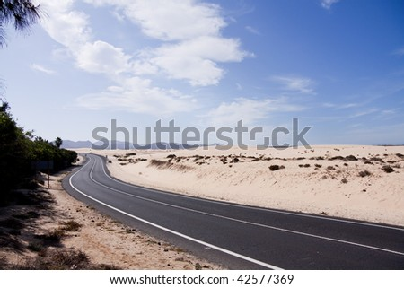 Road in the desert towards the distant rocks