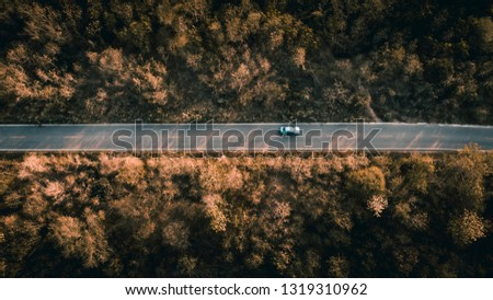 road in the forest on the mountain at pictures style aerial view evening time