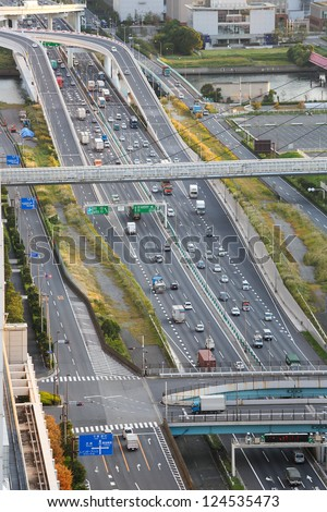 Road in Tokyo with traffic. No commercial information or license plates visible.